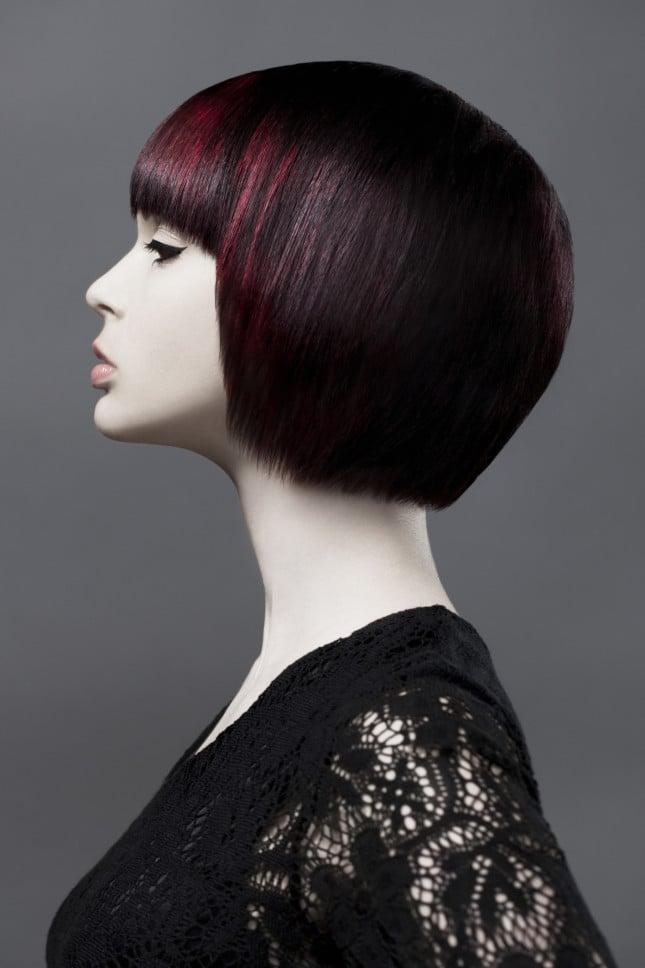 Balayage con ciocche rosse intense su capelli ramati