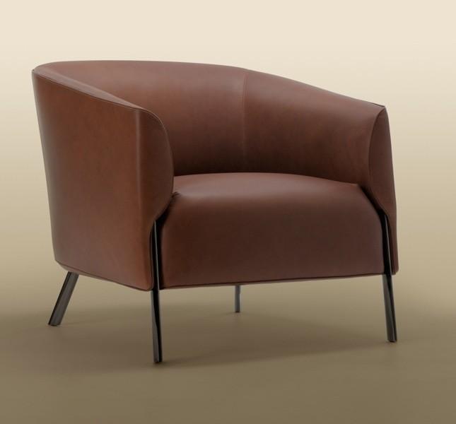 La poltrona Ludovica si adatta perfettamente agli spazi lounge. Disponibile sia in in tessuto che in pelle e tessuto