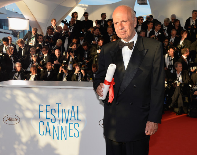 Cannes 2014: iIl produttore Alain Sarde ritira il premio per Jean-Luc Godard / photo: Getty