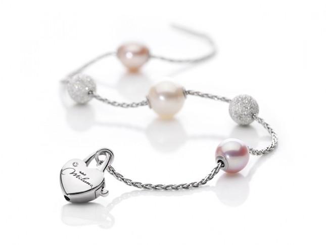 Gioiello componibile in argento e diamante con charms