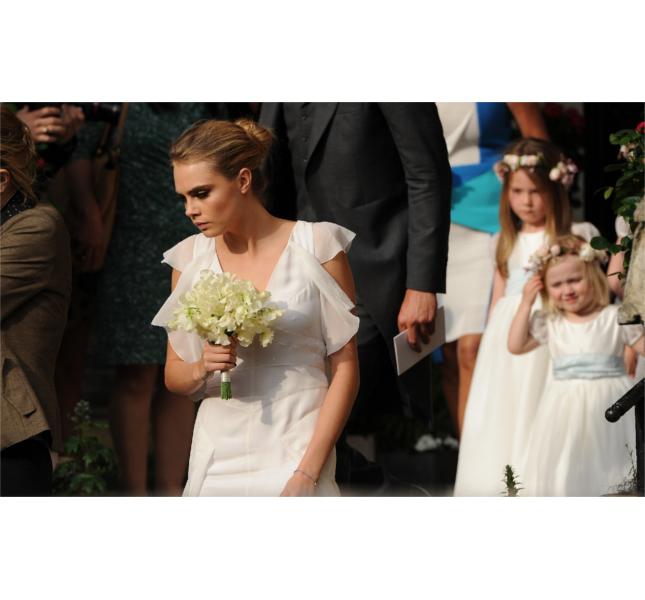 Cara damigella al matrimonio della sorella Poppy Delevingne / photo: Getty