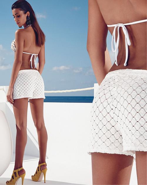 Costume a triangolo Contraire con shorts