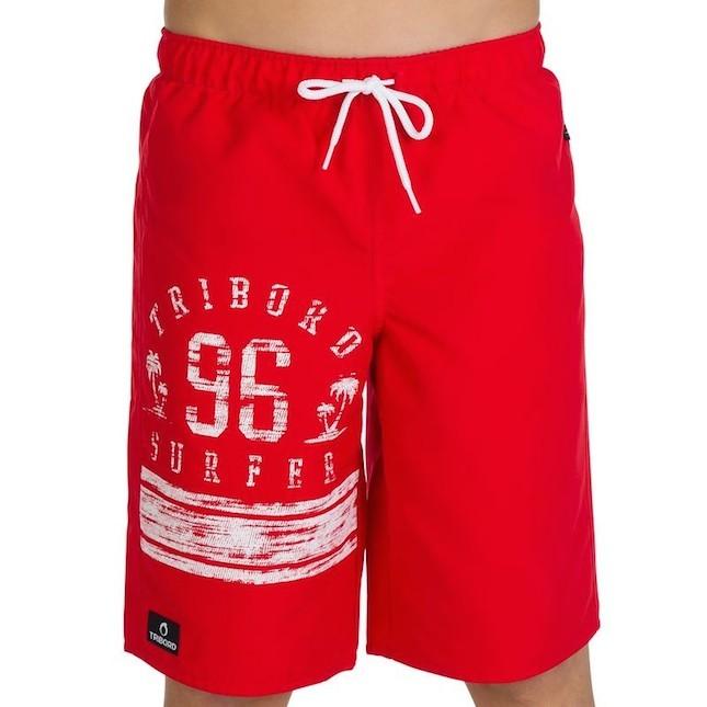 Boxer bambino a tinta unica con logo sulla gamba destra