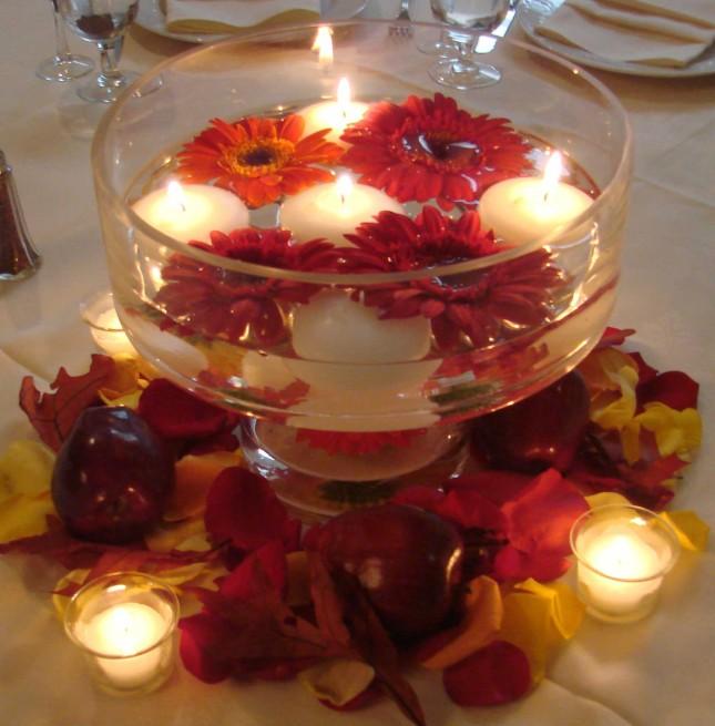 centrotavola con gerbere e candele foto by gaagan