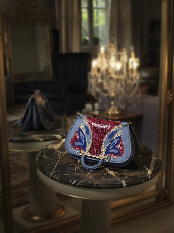Borse a tracolla modello Lady Butterfly Bag, nel colore azzurro, con farfalla stampata, di Borbonese della collezione 2014.