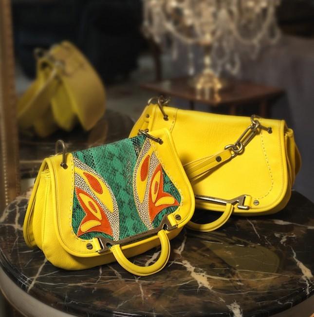 Borse a tracolla modello Lady Butterfly Bag, nel colore giallo, con farfalla stampata, di Borbonese della collezione 2014.