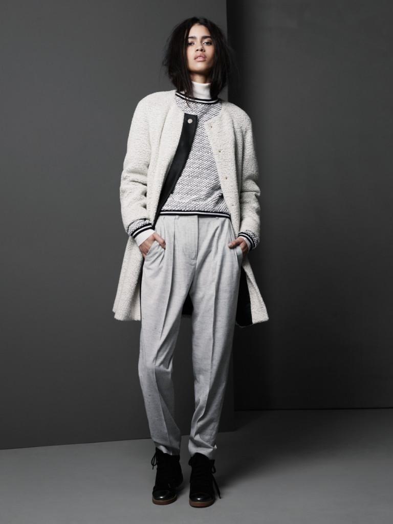 Cappotto e pantaloni dallo stile maschile