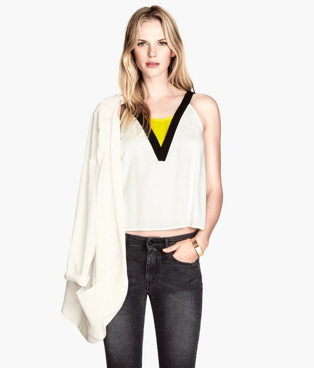 Top bianco con dettaglio nero e giallo di H&M