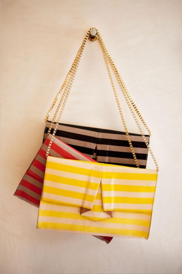 Hoss Intropia collezione estate 2014. Tracolle a righe nei colori: nero, rosso e giallo