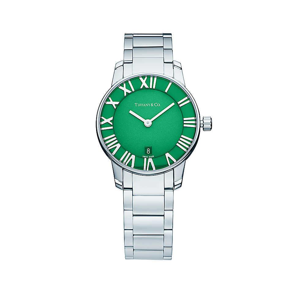 Orologio in acciaio inossidabile con quadrante verde. Cassa di 29 mm, movimento al quarzo, subacqueo fino a 50 metri (5 bar). Di fabbricazione svizzera.
