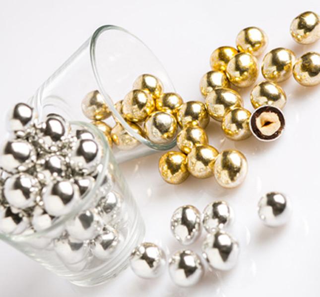 Perle d'oro e d'argento da gustare per festeggiare gli anniversari. Buratti.