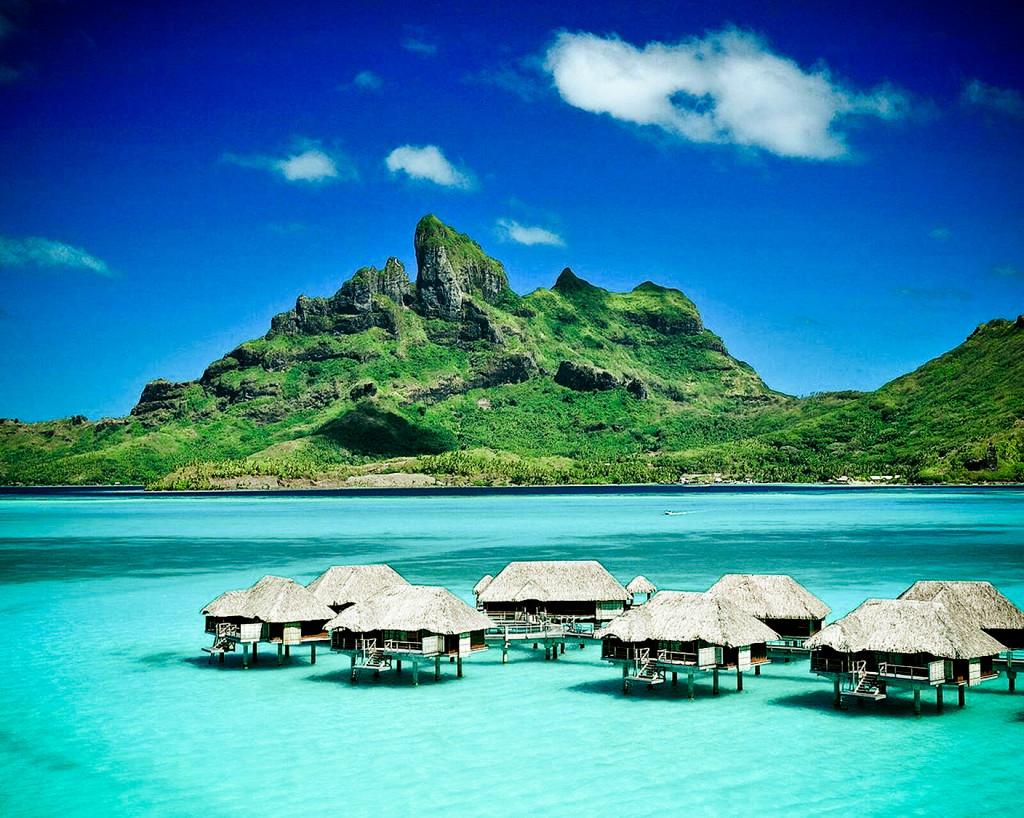 Affacciarsi dal bungalow e specchiarsi nell'oceano Indiano
