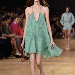 Vestito con drappeggi verde-acqua