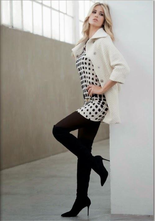 Gioco di quadri neri sull'abitino bianco e cappotto