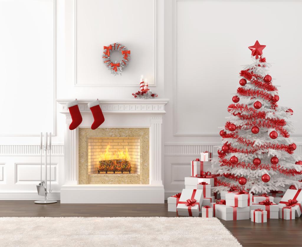 Il vecchio albero di Natale non vi piace più? Acquistate un abete bianco e scegliere addobbi rossi per creare un gioco di contrasti