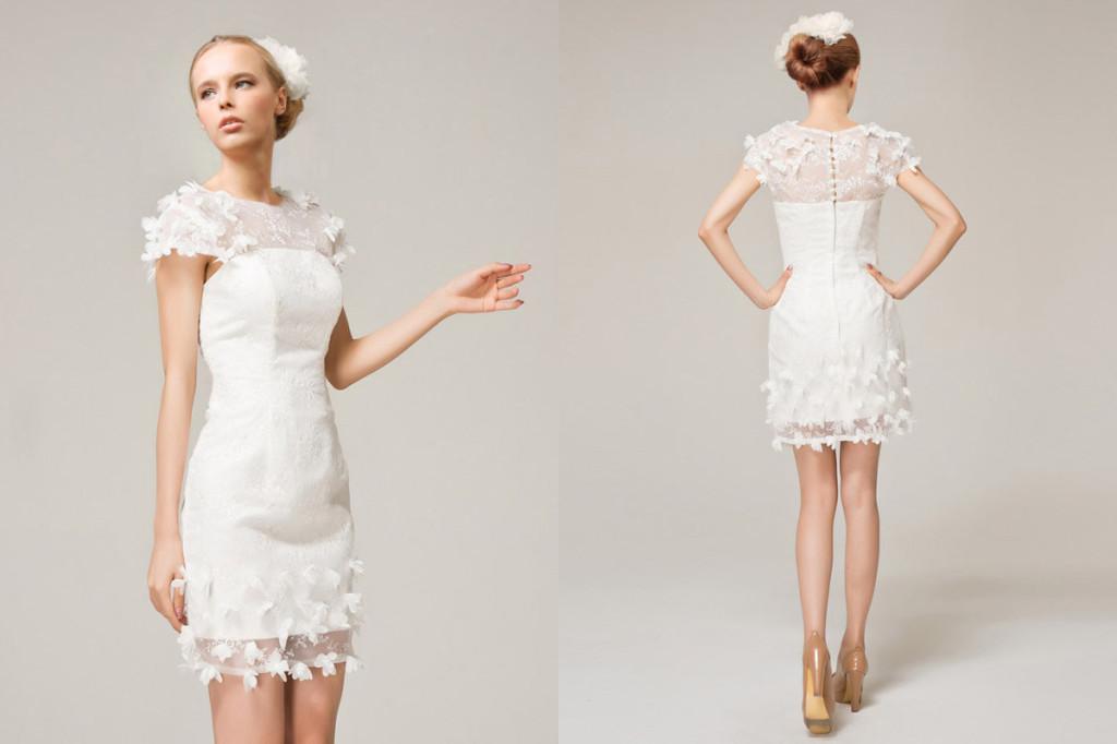 ... di Manuel Mota tradizionale con gonna imperiale e pizzo  Sbarazzino  abito corto in pizzo bianco ... b7a75ced65d