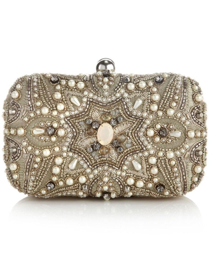sfarvosa clutch di accessorize decorata con perline e pietre tonalità silver rigida