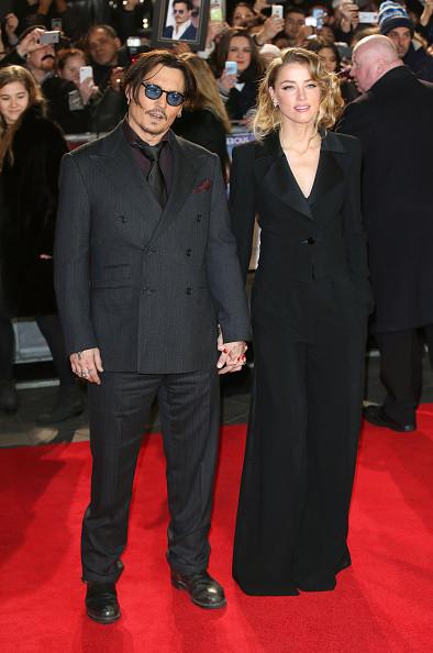 Total black per Johnny Depp e la neo-moglie Amber Heard
