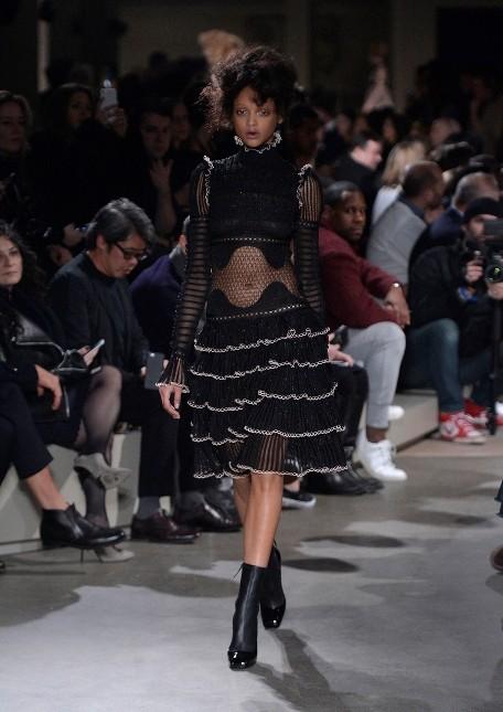 Alexander McQueen minidress nero con balze e corpetto