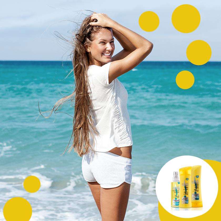 Sotto il sole è fondamentale proteggere i capelli oltre che la pelle