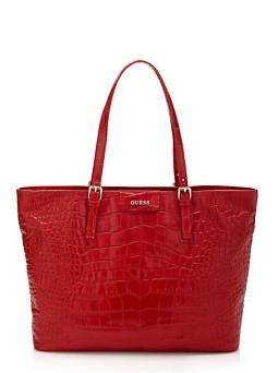 Guess. La Croc Kerry Bag è un accessorio passepartout  essenziale per la stagione più colorata dell'anno