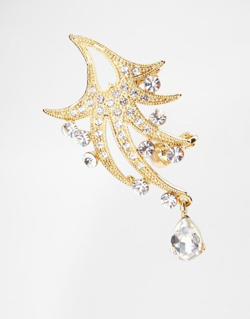 Ear cuff singolo con decorazioni brillanti, pendenti e clips per il padiglione 19,99 euro su Asos