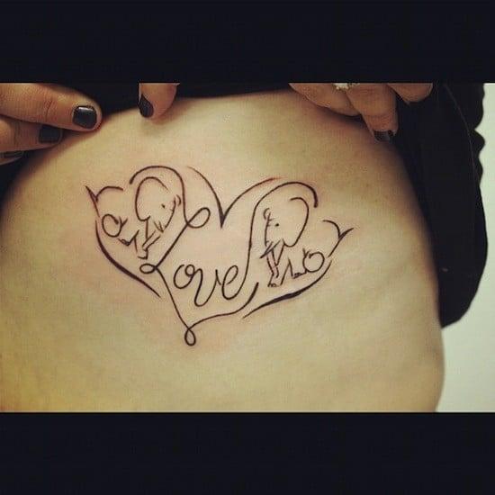 Degli elefantini stilizzati racchiusi in un cuore, per un particolare e senza dubbio unico tatuaggio. Foto di egodesign