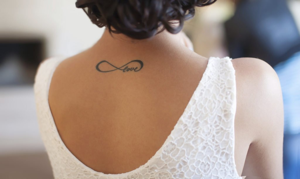 Tattoo on back girl with word love