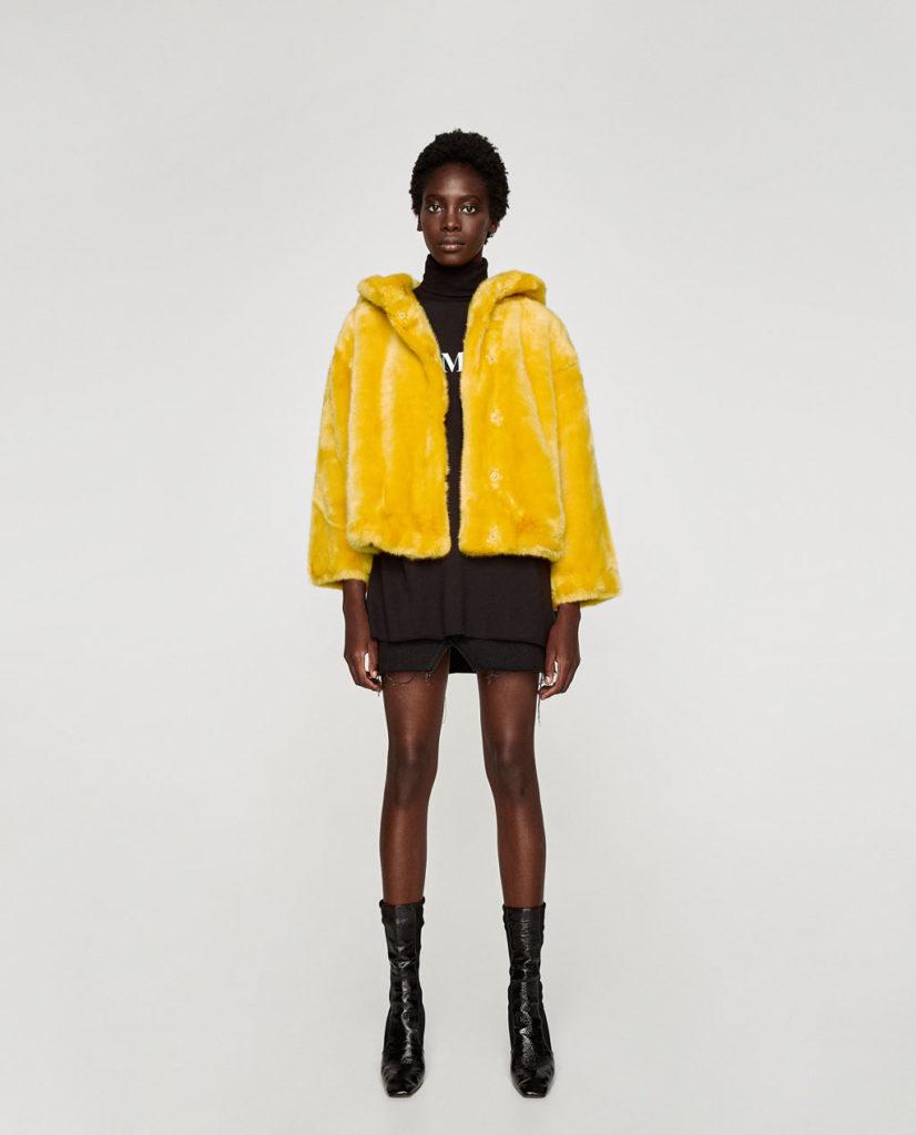 Zara pelliccia ecologica gialla fluo con cappuccio modello corto.