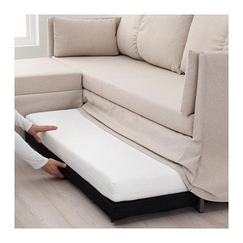 Molto facile l'apertura del divano letto modello Sandbacken.