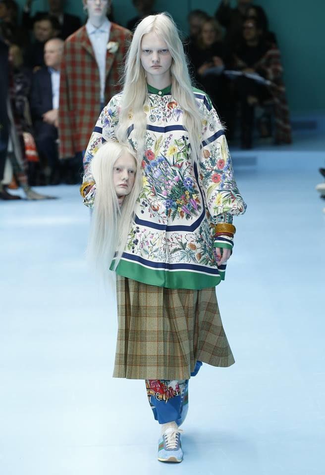 Modella con testa mozzata per Gucci alla MFW FW 2018