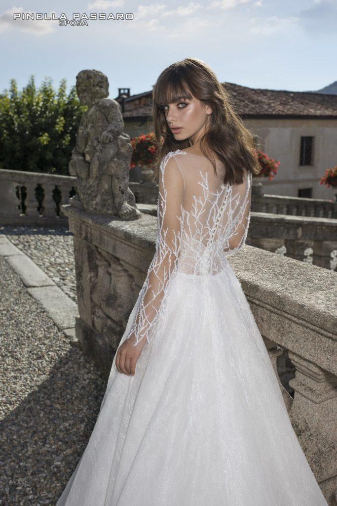modello abito da sposa collezione con maniche Passaro spose